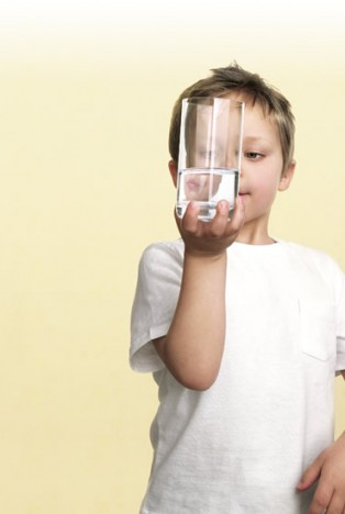 Boy with glass of filtered drinking water